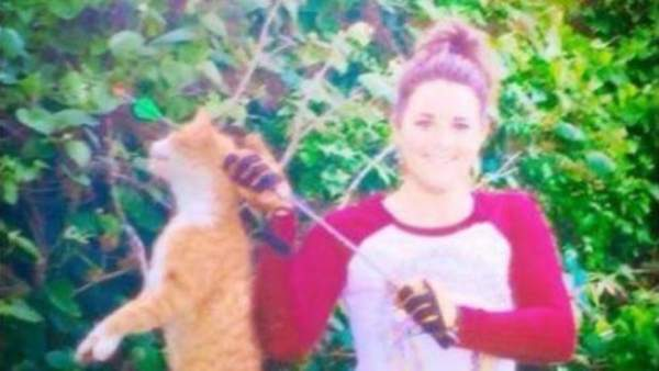 Kristen Lindsey, holding dead cat after she killed it with a bow and arrow. (Facebook)